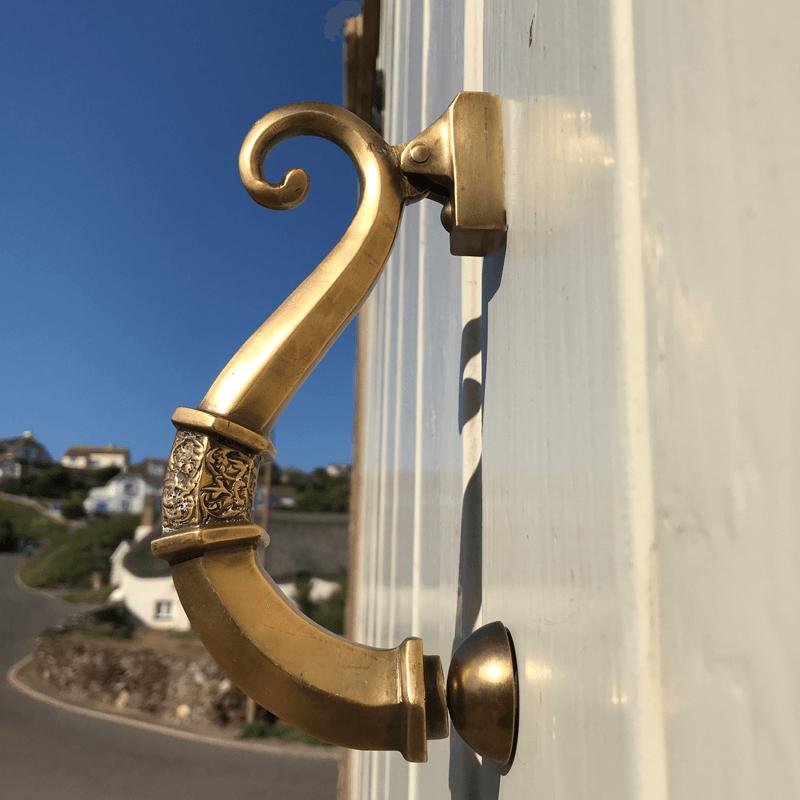 vintage door knocker on cream door