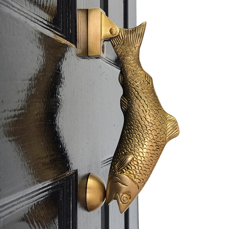 antique Fish Door Knocker on a blue door