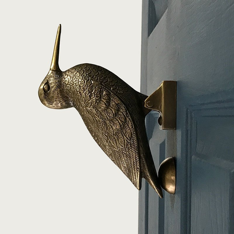 Brass Bird Door Knocker on blue door