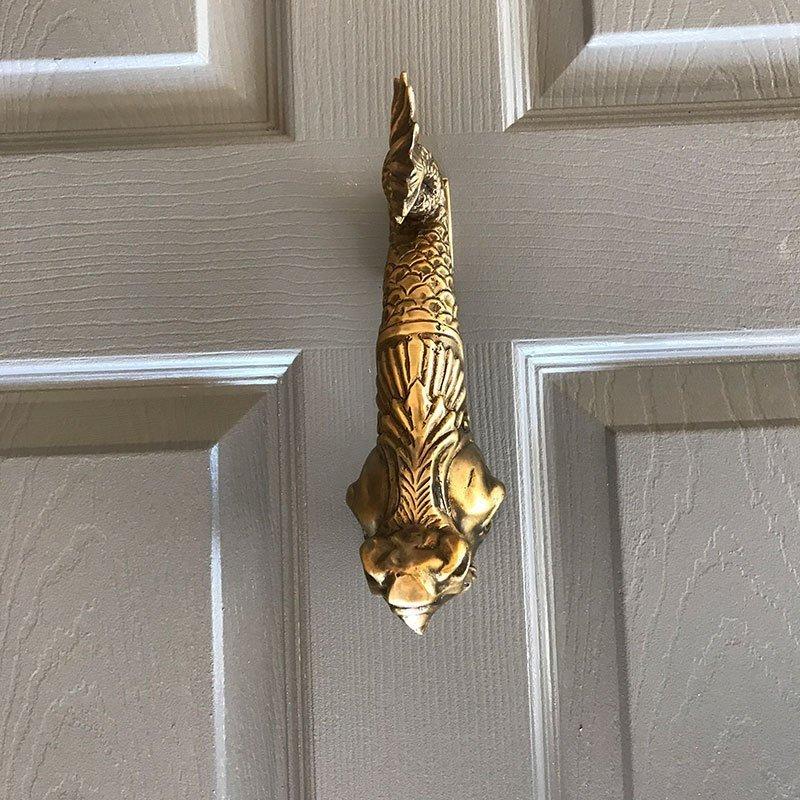 chinese dragon door knocker on grey painted door