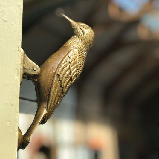 woodpecker door knocker in barn