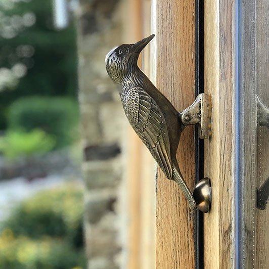 woodpecker door knocker on glass paneled door