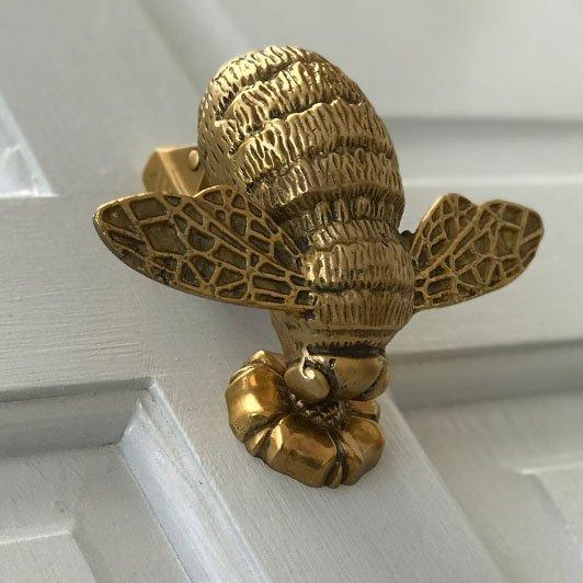 bee knocker on grey door