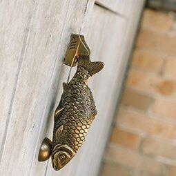 fish door knocker on wood door