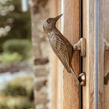 antique woodpecker door knocker